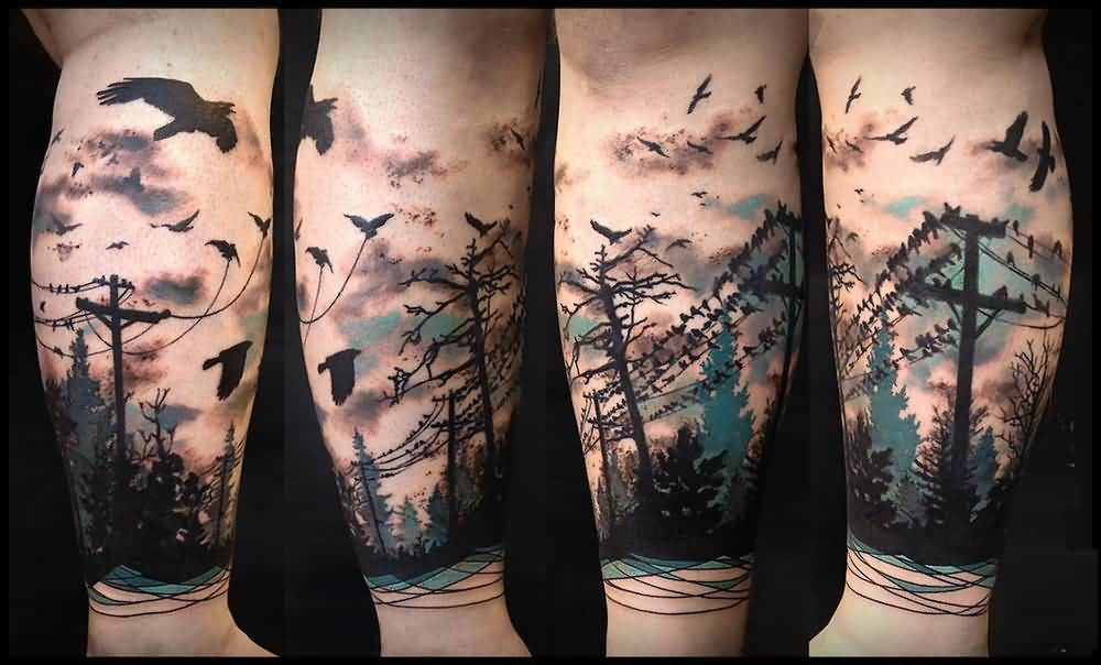 tatuaje de bosque a color con pajaros