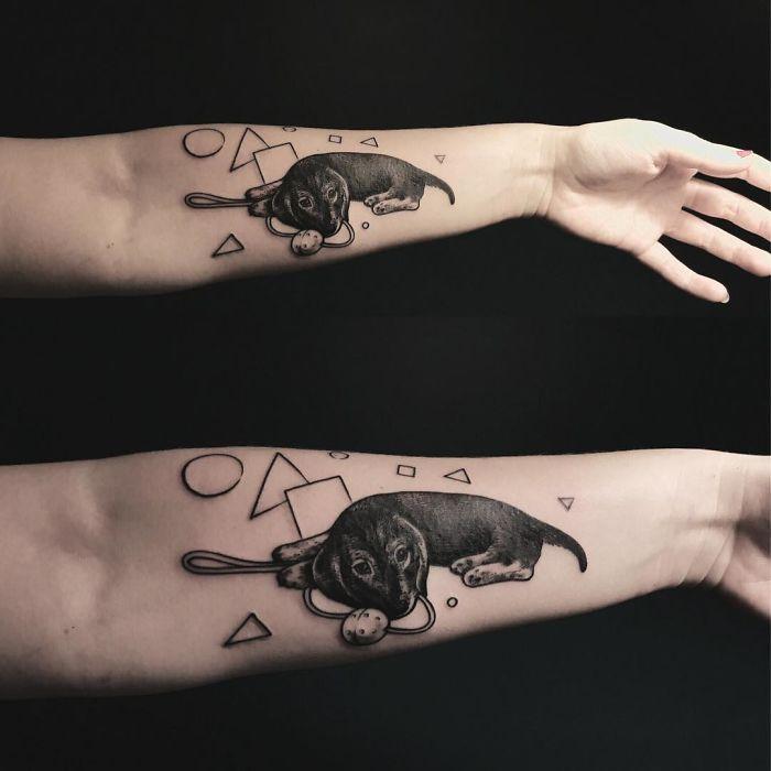 perro con figuras geometricas tatuaje hombre