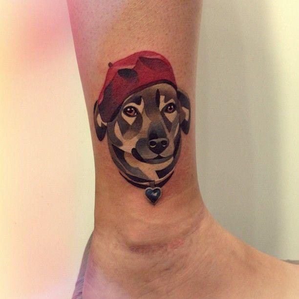 tatuaje de perro pierna