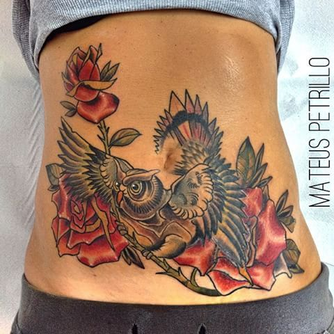 tatuaje de animal para ocultar marcas en el abdomen