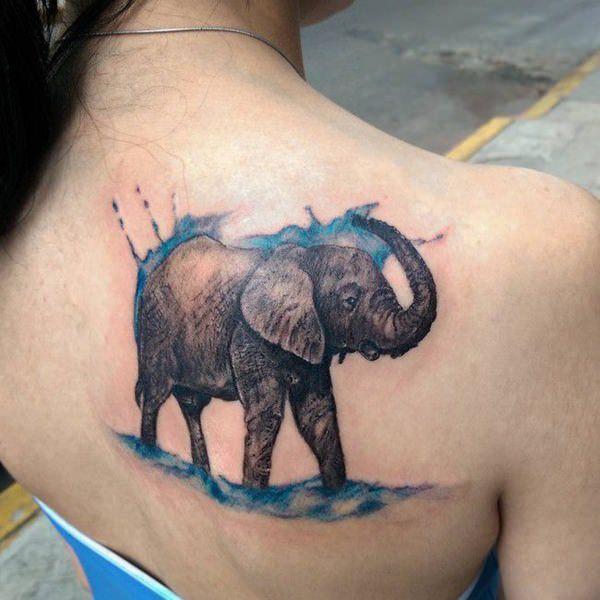 tatuaje de elefante a acuarela en la espalda