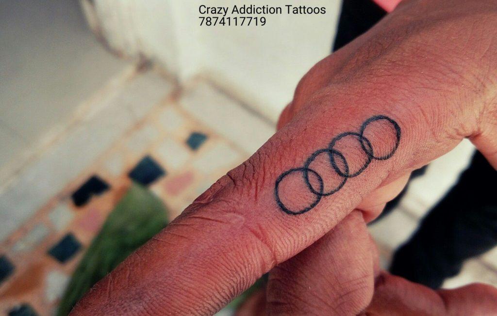 tatuaje circulos de audi