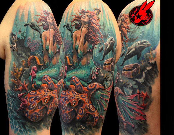 tatuaje de sirena y delfin