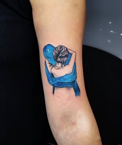 tattoo abrazo al universo