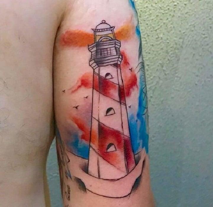 tatuaje acuarela de faro en el tricep