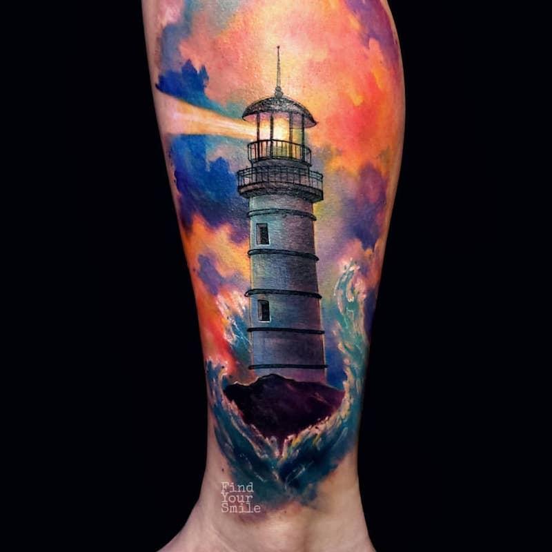 tatuaje de faro alumbrando con estilo acuarela