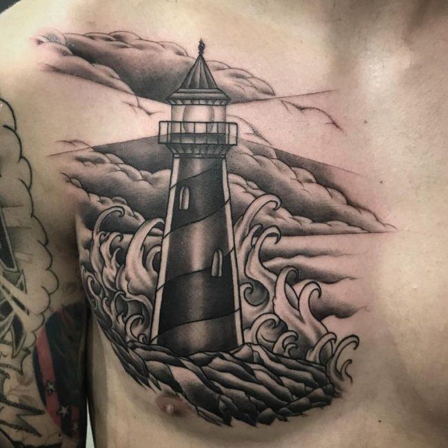 tatuaje de nubes faro y olas