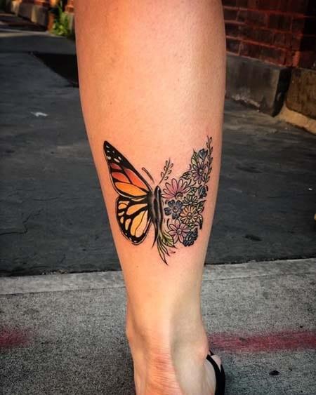 tatuaje de mariposa en la pantorrilla
