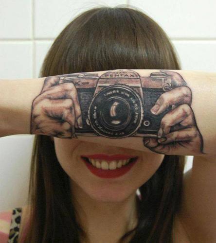 tatuaje de camara fotografica