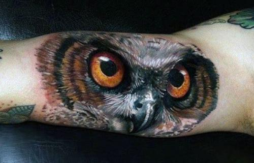 tatuaje de ojos de buhos